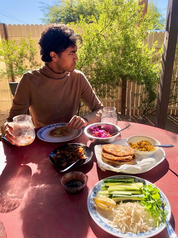 Figure 2. Photograph of Kunal eating a meal in Tucson, AZ.